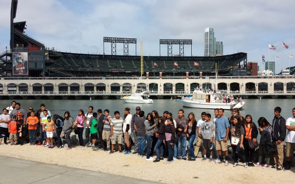 Teens in front of AT&T park and McCovey Cove