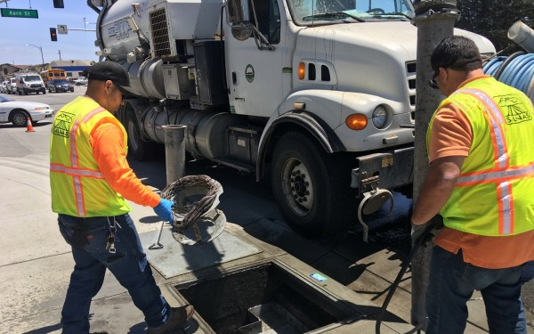 Salinas City Workers preparing to clean out storm drain