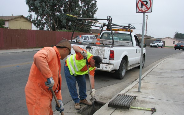 City Workers Cleaning out Storm Drain when dry