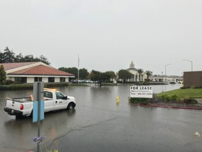 image of Post Dr with City maintenance truck sitting in flood waters.